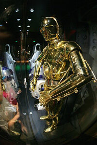 Will we ever have robots like C3P0 and will they in turn change us? See more robot pictures.