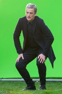 "Actor Peter Capaldi working in front of a screen during filming for an episode of  ""Doctor Who."""