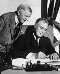 Treasury Secretary William Woodin cheerfully looks on as President Roosevelt signs the 1933 Emergency Banking Bill, one of the steps the federal government took to save the U.S. financial industry during the Great Depression.