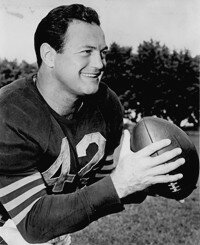 Sid Luckman developed                              an encyclopedic knowledge                                            of the Chicago Bears' offense.                                            See more pictures of football.