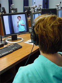 A student learning sign language through video