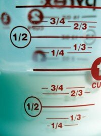 Use a measuring cup to determine the size of your slow cooker.