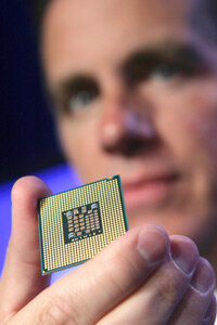Intel vice president Tom Kilroy holds a Dual-Core Xeon Processor 5100 at a press event in San Francisco.