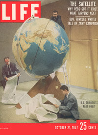 The cover of LIFE magazine from Oct. 21, 1957, shows Smithsonian Observatory scientists working at M.I.T. in Cambridge to try to calculate Sputnik's orbit.