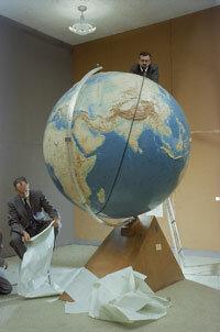 Astrophysicists J. Allen Hynek and Fred Whipple plot the orbit of Sputnik at Harvard.