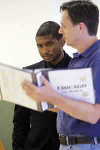 """Stage managers schedule and run rehearsals. Usher, left, rehearses for """"Chicago"""" with stage manager David Hyslop."""