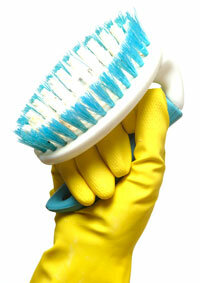 A stiff-bristled brush is one tool you might need for removing stains around the house.