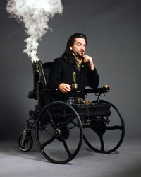 "Kenneth Branagh as Dr. Loveless from ""Wild, Wild West"" in a steam- powered wheelchair"