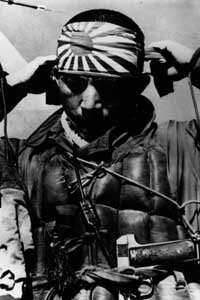 A Japanese kamikaze pilot ties on his honorary ribbon before departing on his suicide mission.