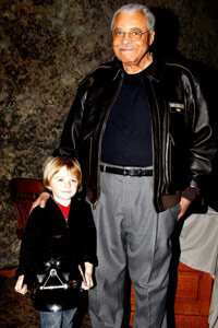 """Actor James Earl Jones, the original voice of Darth Vader, poses with six-year-old Max Page, who played the iconic """"Star Wars"""" character in a 2011 Super Bowl commercial for Volkswagen."""