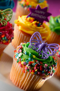 Simply decorated homemade cupcakes look just as festive as an expensive cake from a professional bakery.