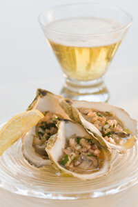 Lightly dressed oysters always have a wow factor, and pair well with herbal or floral beers like India Pale Ales (IPAs).
