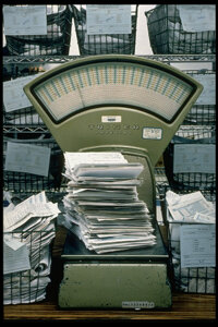 Forms 1040 pile high on a scale at a Philadelphia IRS processing office in 1998.