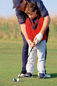 The key to teaching kids to golf is making sure they have fun. See more sport pictures.