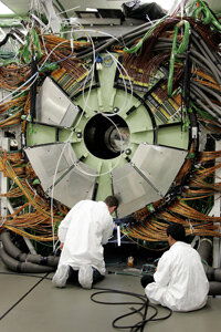 Technicians work on a solenoid magnet for use in the particle accelerator at the CERN laboratory in Switzerland. This accelerator could prove the existence of some of the theoretical particles Lisi used in his E8 model.