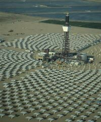 A solar tower surrounded by heliostats
