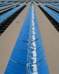 ­Parabolic troughs collect heat for a solar power plant in Mojave Desert, California.­