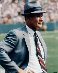 Tom Landry paces the sideline.                              In his mind, he's already a                                            half-dozen plays ahead of                                            the game on the field. See more pictures of football.
