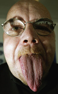 Guinness World Record holder Stephen Taylor displays his 3.74-inch-long tongue.