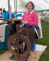 The spinning wheel, formerly a common sight in American homes, is now used more by hobbyists.