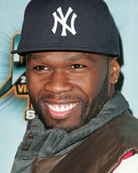 Rapper 50 Cent flashes that famous, trademark smile.