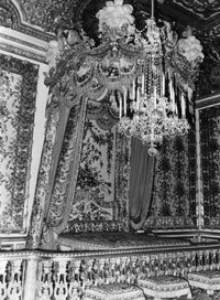 Marie Antoinette's royal bedchamber. Maybe they had stage fright in such ornate surroundings.