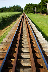 The ties in these train tracks near Queensland, Australia, are wooden, and the rails stretching into the distance look to be made of steel.