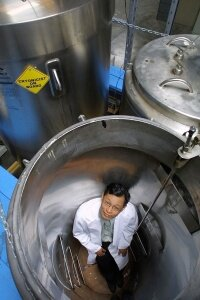 John Rodriguiz, then-president of cryogenics company Trans Time, stands inside one of the empty Cryon tanks used to contain the frozen bodies of humans and other animals.
