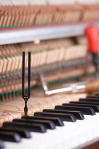 Despite the ease of technology, many piano tuners still use tuning forks.