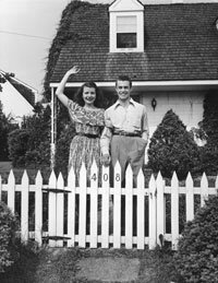 Real Estate Pictures A young couple stands proudly by their piece of the American dream in 1947. See more real estate pictures.