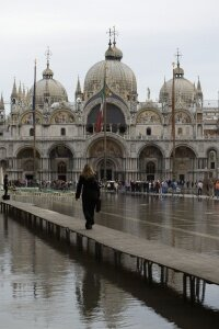 To cope with the flood conditions, elevated walkways have been constructed to help residents go about their business, as shown here in front of the Basilica of San Marco.