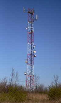Gearing up for a 3G world: Phone companies must strengthen their cell phone towers for new features. ­
