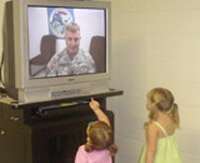 Army Sgt. 1st Class Jeffrey Everman visits with his children in Texas.