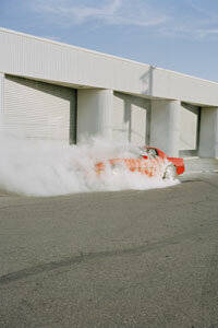 Somewhere in this haze of smoke, a precision driver performs a wicked burnout.