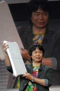 Nintendo video game designer Shigeru Miyamoto displays the Wii Balance Board, created to accompany the Wii Fit game, at a conference in 2007. The board uses sensors to track a user's weight and movements. See more video game system pictures.