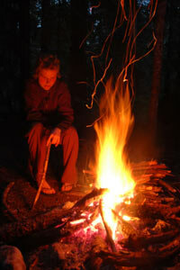 A campfire can provide warmth and light, as well as help bolster a lost hiker's spirits.