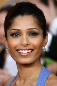 Actress Freida Pinto makes her eyes pop with smoky blue liner and deep plum shadow.