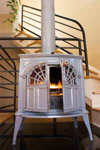 A wood stove burning in a modern condo.