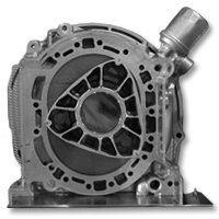 The rotor and housing of a rotary engine from a Mazda RX-7: These parts replace the pistons, cylinders, valves, connecting rods and camshafts found in piston engines.