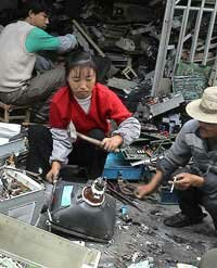This woman in Guiyu, China, was about to smash the cathode ray tube off a computer monitor to retrieve the copper-laden yoke. The lead-laden glass is a hazard, and toxic phosphor dust coats the inside of the monitor.