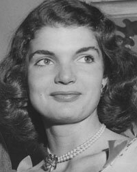A young Jacqueline Bouvier chooses pearls for a social event.