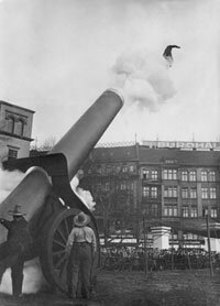 A human cannonball flies through the air after being fired from a cannon.