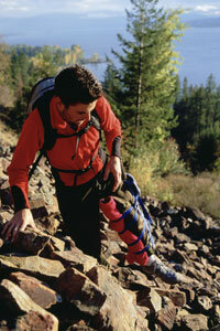 This injured hiker has made a homemade splint to help make his way to safety.