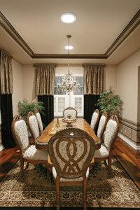 Sunlight brightens a dining room.