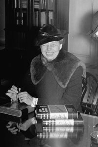 """Eleanor Roosevelt was one of the most active first ladies in the history of the United States. Here, she autographs copies of her book """"This Is My Story."""""""