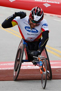 Two-time defending champion Kurt Fearnley, of Australia, crosses the finish line of the Chicago Marathon with a time of 1:29:09 on Sunday, Oct. 11, 2009.
