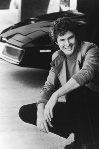 Actor and singer David Hasselhoff poses next to the computerized car, KITT, c. 1985.