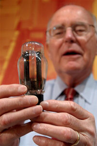 Gordon Moore holds a vacuum tube, the precursor to transistors.