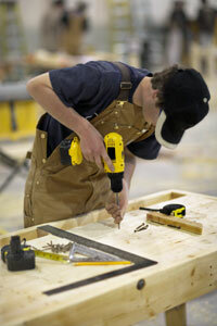 Assembly-line workers are often paid hourly wages. See more power tool pictures.