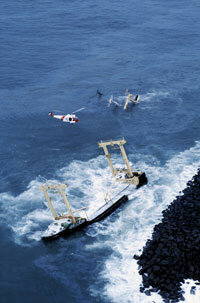 This sinking oil tanker nearly reached the shore.